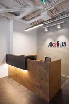 Akelius Montréal _ Russian plywood and raw steel reception desk.  The warm wood tone brings warmth to a clean backdrop
