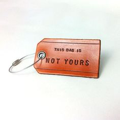 Leather luggage tag: This bag is not yours.