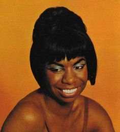 Nina Simone is the singer of songs that touch the soul. Pure talent in voice and fingertips.
