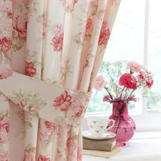 "These floral ""annabella"" curtains from dunelm mill currently hang at our living room window. I've replaced the matching tiebacks with a sage green rope tie back with a beaded tassle."