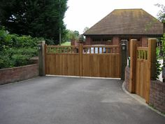 """Here's a better picture of our Oak Henton gates . Wooden Garden Gate, Garden Gates, Driveway Entrance, Entrance Gates, Cotswold House, Wood Gates, Electric Gates, Gate Design, House Goals"