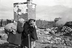 Russian civilians looking at the ruins of their former home at Serpukhov south of Moscow, Russia, late 1941 or early 1942