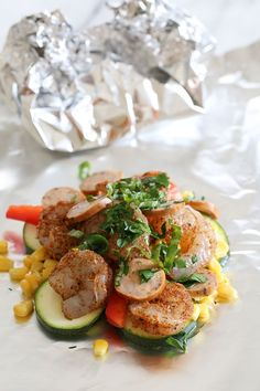 This dish is so easy to make, anyone can do it! Spicy shrimp seasoned with Cajun spices, Andouille sausage, and rainbow colored vegetables are baked together in foil pouches. They are fast and easy to make, and can be made ahead and kept in your freezer. When you