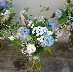 Handtied Bouquet made with Blue Hyacinth, Pink Larkspur, Sedum and Seasonal Foliage, grown and arranged by Sussex Cutting Garden.