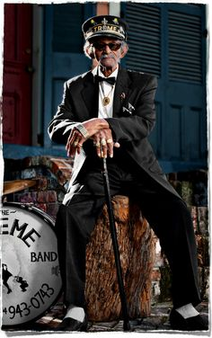 """""""Uncle"""" Lionel Batiste is a debonair 81 year old New Orleans jazz and blues musician, singer, historian, a bass drummer and assistant leader of the Tremé Brass Band. This poster of him is available at www.treme2012.com"""