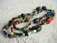 Fabulous handblown glass bead necklace. Made from a variety of large and small handblown glass beads. including venetian glass, trade beads, and random shapes. A huge mix of colors and sizes make this a fascinating piece of art. This would be a wo...