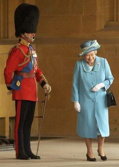 """A great photo of the Queen"""" laughing"""" as she passes her husband, the Duke of Edinburgh in uniform. Imagine the conversation over lunch!"""