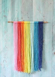 Rainbow Macrame Wall Hanging Rainbow colored yarn and giant paper flowers make u… - DIY FLOWERS Rainbow Paper, Rainbow Crafts, Rainbow Wall, Yarn Wall Art, Yarn Wall Hanging, Wall Hangings, Paper Wall Decor, Wall Hanging Crafts, Art Yarn