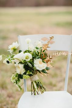 green and white bouquet with gold painted ferns, photo by Sara and Rocky http://ruffledblog.com/st-patricks-day-wedding-ideas #bouquets #flowers #weddingbouquet