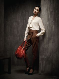 Look 17 - Bowtie silk twill blouse  Rayon blend pleated pants - Mongolian 'Snake' embossed cow leather hobo