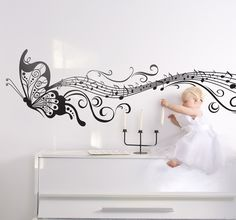 A beautiful mono-colour wall decal of a butterfly leaving behind a musical trail. Ideal for music lovers to decorate their bedroom in an elegant way. #Butterfly #Sticker #Decoration