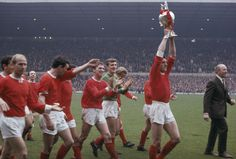 @manutd won the old Division One title seven times between 1908 and 1967. In this shot, club legend Bill Foulkes proudly parades the '67 league trophy in front of a packed Old Trafford.