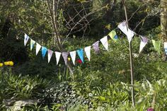 DIY outdoor bunting made from old plastic bags! (Could also use colourful plastic tablecloths and staples!)