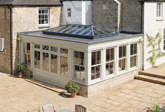 David Salisbury orangery lounge in Gloucestershire Orangerie Extension, Contemporary Garden Rooms, Roof Extension, Farmhouse Renovation, Small Garden Design, House With Porch, House Extensions, Lounge, Home