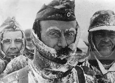 Three German soldiers covered in snow and ice during winter on the Eastern front.