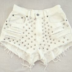 White cut off studded denim shorts. High cut. Silver punk style studs. Holes, rips and super frayed. Perfect. Made in USA. FOR THE HIGHNESS.