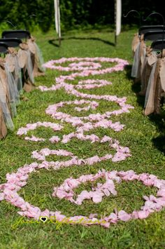 Aisle Decor - Petal Decorations - Outdoor Wedding Ideas - Ceremony Ideas - Ceremony aisle decor - bows - burlap - lace - rustic chic - country wedding ideas - country wedding outside - aisle decorating wedding - wedding florist Knoxville Tn - Simple and elegant - Pink flowers - pink roses - Pink wedding theme. - www.lisafosterdesign.com