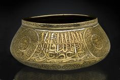IRAN, probably SHIRAZ:  Bowl - 14th c. Brass, silver inlay,  24.1 cm (diam.)