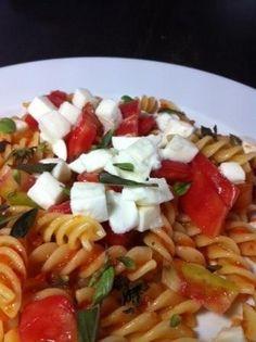 Fusilli Caprese - fruity tomato sauce, mozzarella cheese cubes and fresh basil - perfect for hot summer days.