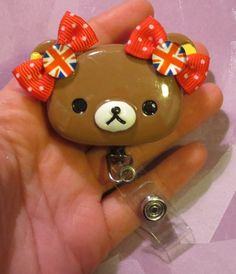 British Cutie Rilakkuma Teddy Bear Id Badge Reel by EvezBEADz  Handmade by me.  Clip-on retractable reel.  Attach this cutie anywhere; clothing, back pack, or purse!  Clear plastic id badge holder wit