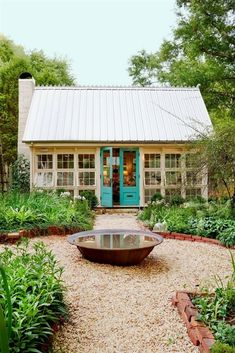 """Last year, the """"she-shed"""" emerged as the female answer to the man cave. Now there's a sophisticated new crop of chic sheds—sunlight-drenched spaces nestled in equally inviting backyard gardens. Here, one lucky owner invites us in. #BackyardGardening"""