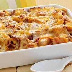 Layers Of Potatoes Bacon Cheddar Cheese And Eggs Bake Overnight In The Slow Cooker For An Easy And Delicious Brunch Casserole For Holiday Mornings