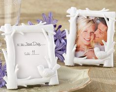 Use dove frames to display pics of Jas on tables as centerpieces.