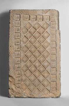 Architectural Brick for a Tomb  Artist/maker unknown, Chinese  Geography: Excavated at or near Zhengzhou, Henan Province, China, Asia Date: 25-220 Medium: Earthenware with impressed and incised decoration Dimensions: 31 7/8 × 18 1/2 × 5 7/8 inches (81 × 47 × 15 cm) Curatorial Department: East Asian Art * Gallery 233, Asian Art, second floor  Accession Number: 1923-21-620 Credit Line: Gift of Charles H. Ludington from the George Crofts Collection, 1923