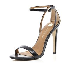 Black barely there stiletto sandals<---- classy!