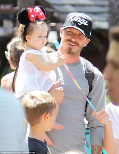 Minnie Mouse: The Beckham clan take a trip to Disneyland, California, with David carrying Harper in his arms