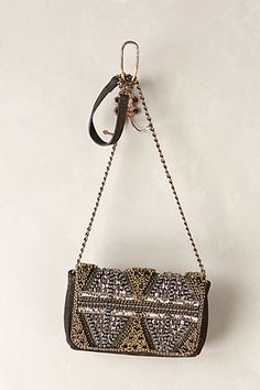 I would never spend this much for a bag to carry my junk around in, but it's very pretty.