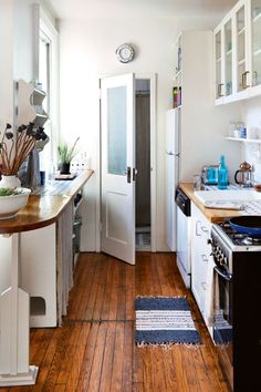 7. Vintage Aya changed little about the galley kitchen and instead focused on creating an eating and reading nook...