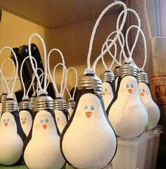 recycle old lightbulbs into penguin ornaments