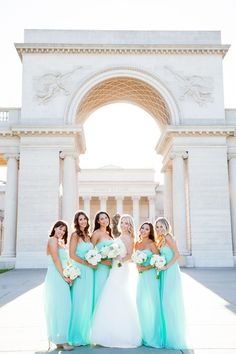 Bridesmaids looking lovely in class chiffons dresses. Love that aqua color! {@brianacphoto}