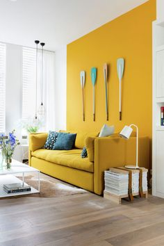 Smart modern kitchen-diner with mustard yellow feature wall | Diners ...