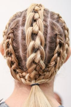 A bevy of braids and knots at Threeasfour were gathered into a ponytail at the nape.