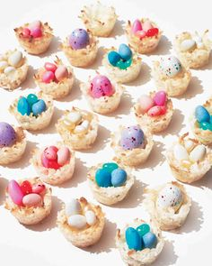 Three ingredient coconut macaroon (coconut, egg whites, and salt) fill with chocolate eggs or jelly beans.