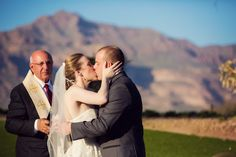 You may kiss the bride! - Photography: Trevor Dayley Photography - trevordayley.com  Read More: http://www.stylemepretty.com/little-black-book-blog/2013/09/05/arizona-mountain-wedding-from-trevor-dayley-butterfly-petals/