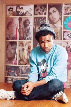 Donald Glover / Childish Gambino decked in powder blue iconic Mickey Mouse sweater