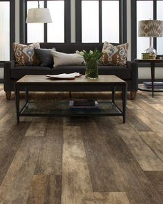 Premio Plank in Novella by Shaw Floors. Here's a highly sophisticated reclaimed visual inspired by weathered, skip-sawn wood. This stunning resilient plank appears to have years of age and patina – a refined reclaimed look that goes casual or elegant.