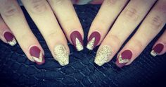 Gorgeous, elegant wine red nails with gold glitter design.