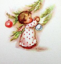 Baby Angel decorating tree.