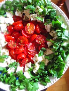 Isn't it pretty? And pretty simple to make too!          Arrange equal parts cherry tomato halves, cubed feta and torn spinach leaves in a s...