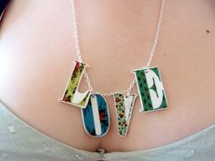 Love Letter necklace - floral patterns - summer bunting - hand illustrated pendants by Floralchic, via Etsy.