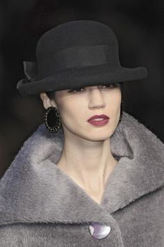 Mariella Burani...love the combination earings, red lipstick and hat!! Got a hat just like that :)