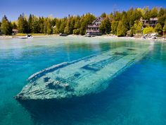 There are over 6,000 shipwrecks in the Great Lakes, most of which have not been accessed by people. But there are some wrecks visible in shallower waters, including the schooner Sweepstakes, located in Lake Huron's Big Tub Harbour in Fathom Five National Marine Park. The boat sank about 50 yards from the shore in September 1885 and has remained surprisingly intact ever since, making it a popular attraction for divers and tourists.