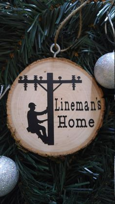 Wooden lineman ornament by CrackerChild on Etsy