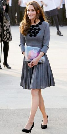 Kate Middleton wearing Tiffany & Co. Elsa Peretti Diamonds by the Yard Bracelet in Platinum, Jimmy Choo Lovely Pumps, Garrards Jewellers Royal Engagement Ring and Orla Kiely Grey Pleated Flower Detail Dress.