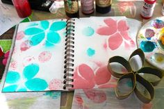 Stamping Flowers with toliet paper or paper towel rolls.