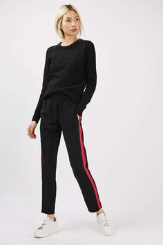 Go for the sporty look in these black woven tapered joggers, featuring red side stripe detail and elasticated waistband. Jogger Pants Outfit, Black Jogger Pants, Trouser Outfits, Hipster Fashion, Fashion Pants, Women's Fashion, Fashion Dresses, Side Stripe Trousers, Hipster Pants